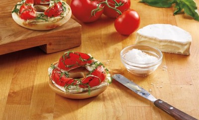 bagel with tomatoes cream cheese and basil