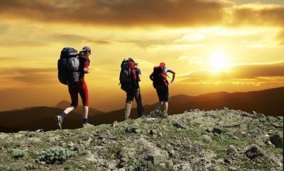 three people hiking on mountain