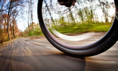 spinning bicycle wheel outdoors on trail