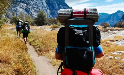 three people backpacking