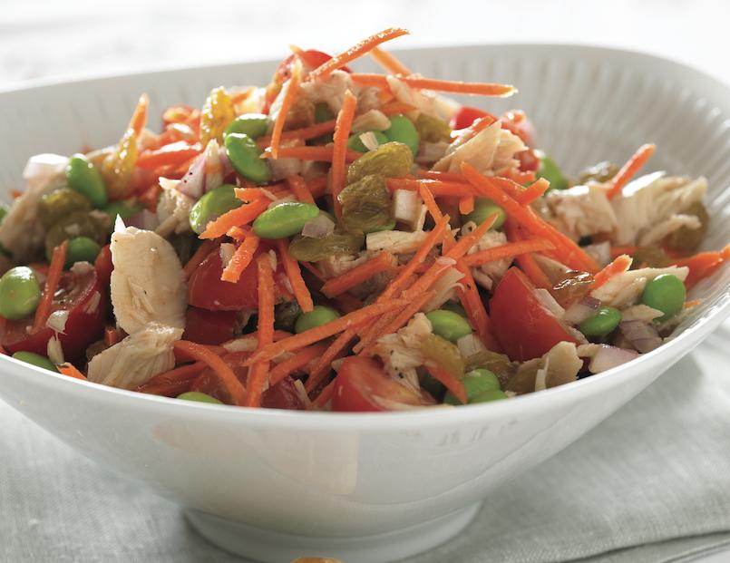 tuna edamame salad in white scalloped bowl