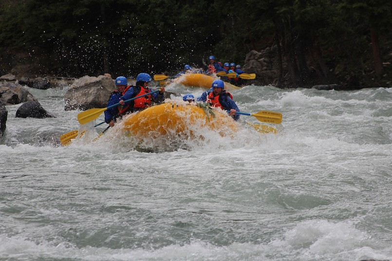 two groups of white water rafters