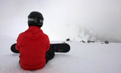 snowboarder waiting for the clouds to clear