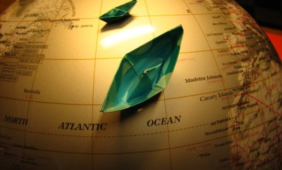 paper boats on a globe