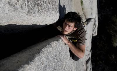 sweat on man climbing rock