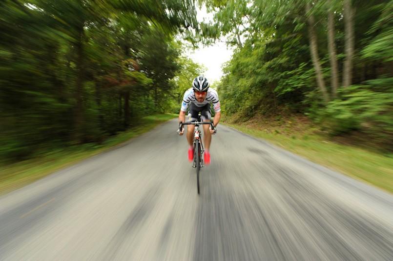 man cycling toward camera