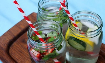 infused water in mason jars with red and white straws