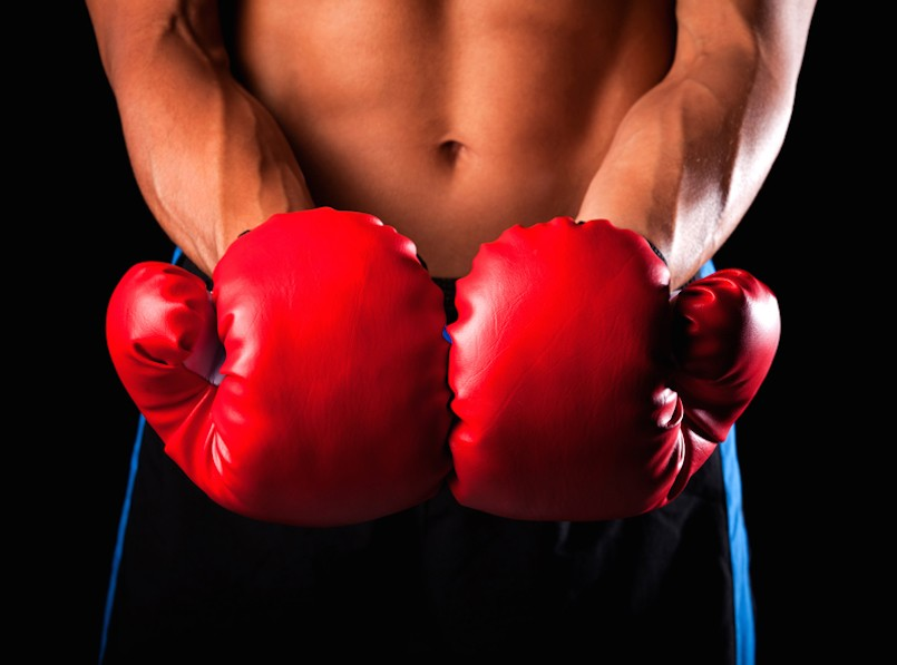 male boxer with red kickboxing gloves