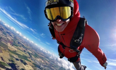 Erik Roner skydiving in red BASE jumping suit