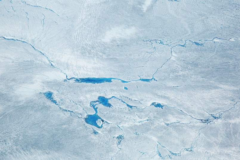 Supra glacial Lakes over the Ice Sheet in Greenland. Aerial Shot.