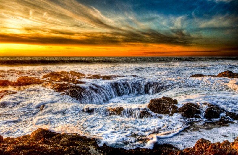 Thor's Well on the central Oregon Coast is a water spout in reverse