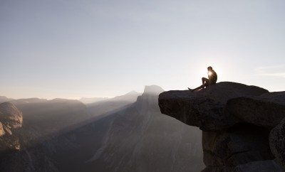 rock climber sitting on ledge in Yosemite national park