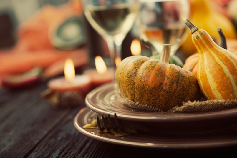 Autumn table setting with pumpkins. Thanksgiving dinner and autumn decoration