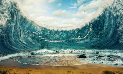 Surreal image of huge waves surrounding dry sand
