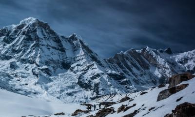 snow mountains under dark sky