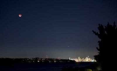 full moon over Seattle city skyline at night
