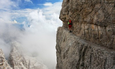 A man going through the difficult part of ferrata - Dolomiti mountains, Dolomiti di Brenta, Italy