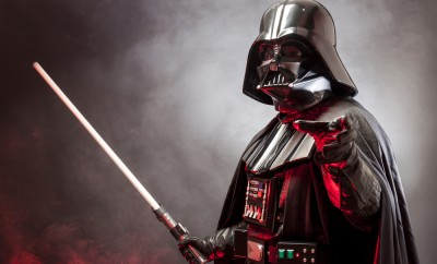 Portrait of Darth Vader costume replica with grab hand and sword