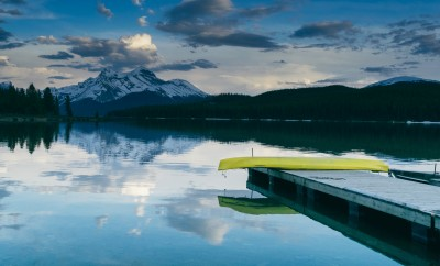 bright kayak on dock over lake with mountains