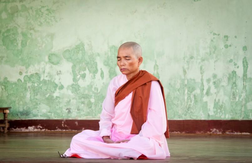 Buddhist nun praying for the full moon festival, Shwedagon Pagoda
