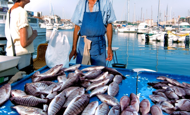 France. Marseille. Fish Market. Yachts. The seller and buyer