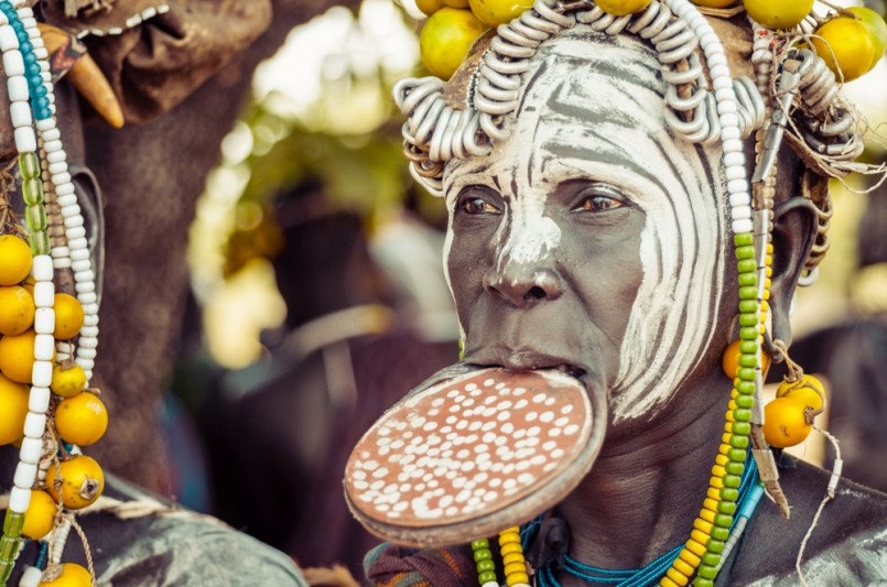 unidentified woman from Mursi tribe with big lip Plate. In the Mursi tribe, the more the lip plate is big, the more the woman is considered beautiful