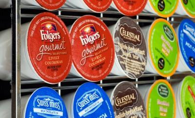 Variety of K-cup flavors on a storage rack to be used in a Keurig single serve beverage maker