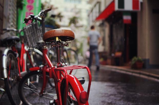 red bike on rainy city street