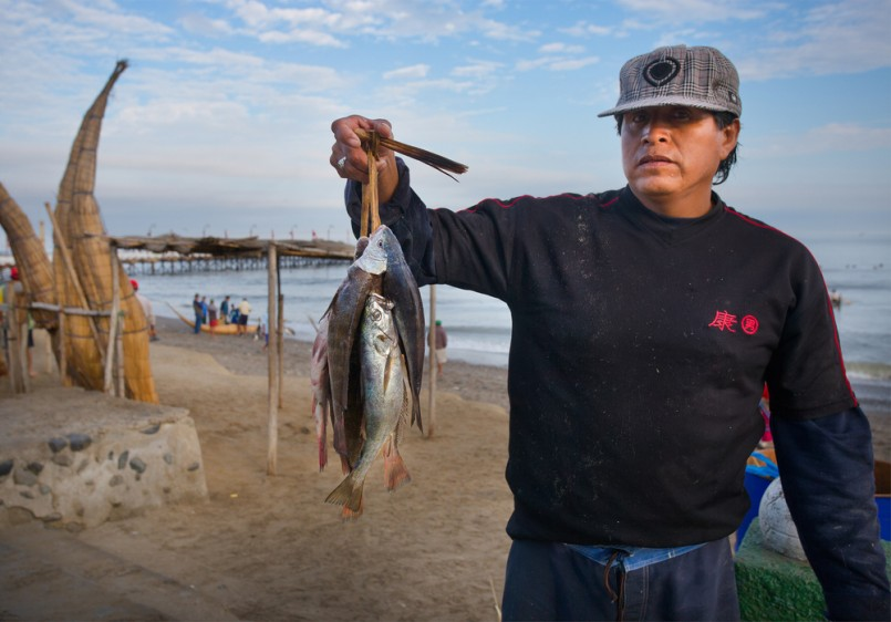 A unidentified man shows the fishing circa