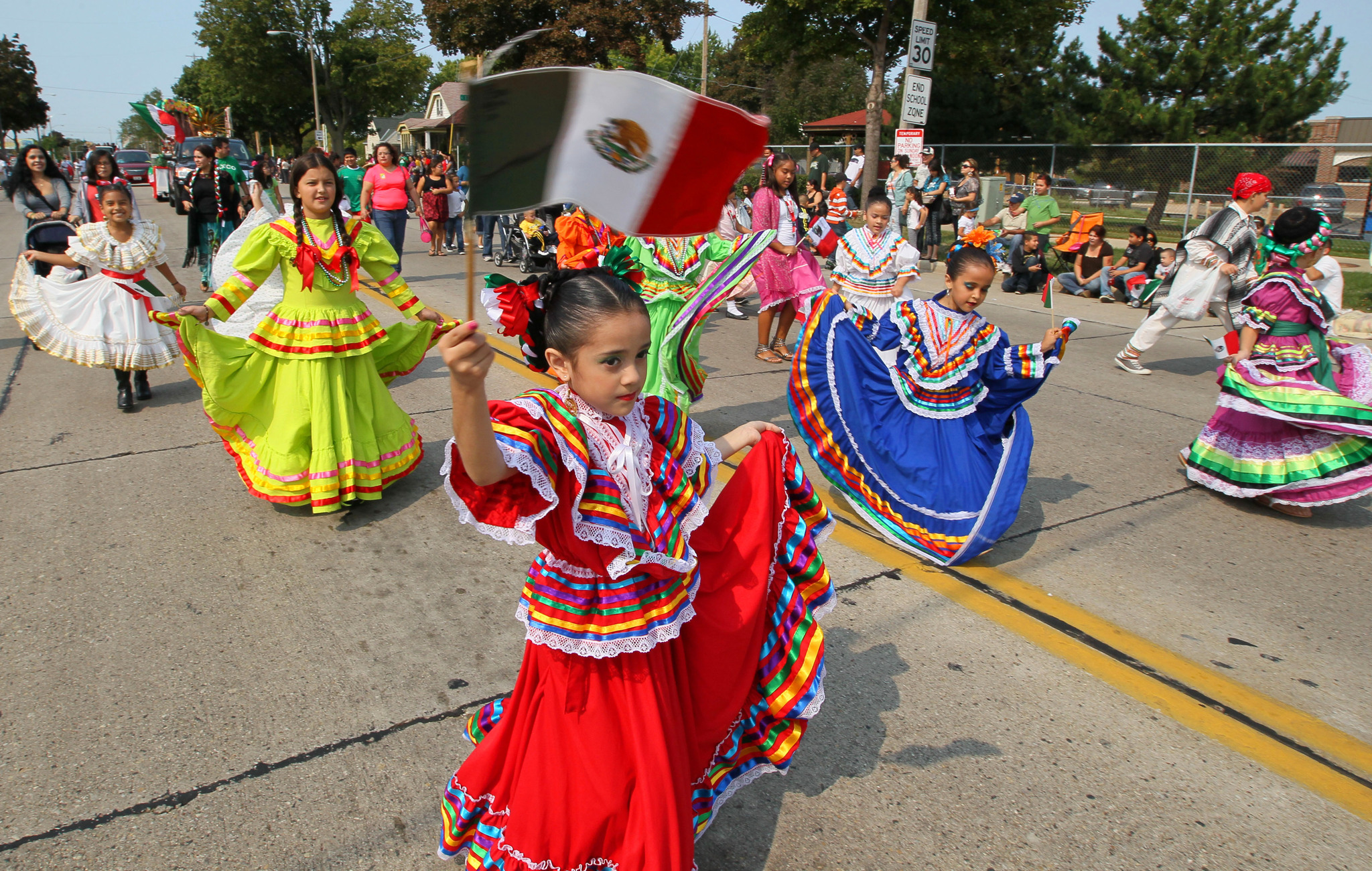 September 16, 2012 Photographs from the Mexican independence day parade. It kicked off at S.20th and Oklahoma and ended at the UMOS center at 2701 S. Chase Ave. The event celebrates the Mexican War of Independence, from Spanish colonial authority. Dancers in traditional Mexican dresses filled the street with color as they passed. MICHAEL SEARS/MSEARS@JOURNALSENTINEL.COM