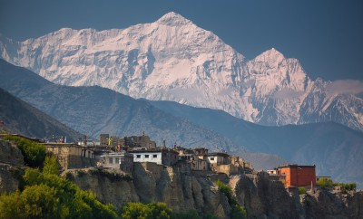 Rural life in front of Incredible Himalayas. Nepal, ACAP, Upper Mustang, Kagbeni village (2,810 m) and Nilgiri North (7,061 m)