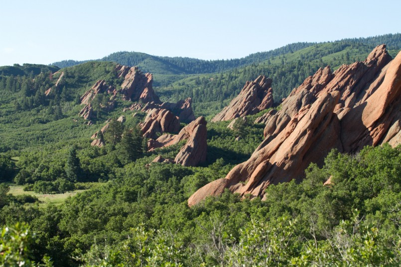 Red sandstone cliffs with green forest below