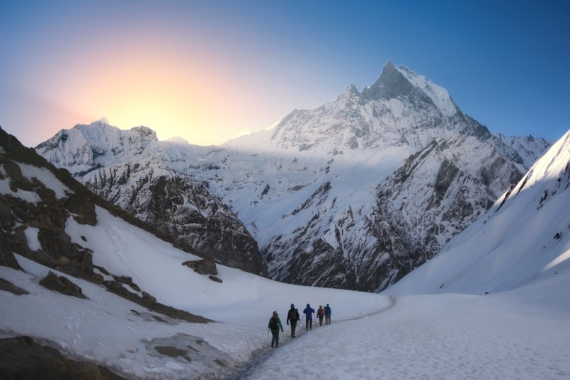 A group of trekkers are walking in the mountains. Nepal, Himalayas, Annapurna region