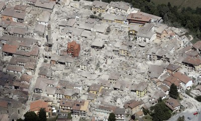 This aerial photo shows the damaged buildings in the town of Amatrice, central Italy, after an earthquake, Wednesday, Aug. 24, 2016. The magnitude 6 quake struck at 3:36 a.m. (0136 GMT) and was felt across a broad swath of central Italy, including Rome where residents of the capital felt a long swaying followed by aftershocks. (AP Photo/Gregorio Borgia)           NYTCREDIT: Gregorio Borgia/Associated Press