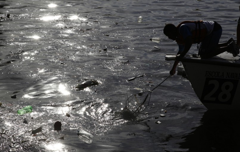 a student shows the garbage and debris found at the Guanabara bay in Rio de Janeiro. Olimpycs' sail competition will be held at the bay.