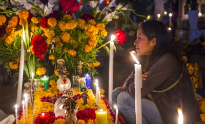 Unidentified woman on a cemetery during Day of the Dead in Oaxaca, Mexico