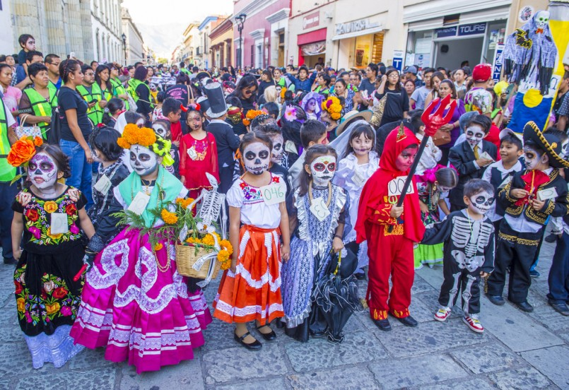 Unknown participants on a carnival of the Day of the Dead in Oaxaca, Mexico
