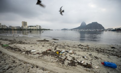 Garbage and pollution from Guanabara Bay wash ashore on Botafogo Beach in front of Sugarloaf Mountain in an ongoing concern for the summer Olympic Games.