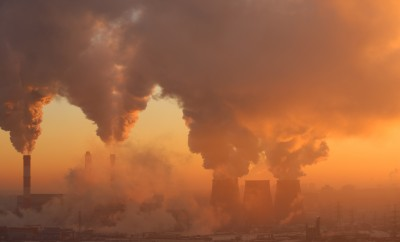 Polluting factory at dawn