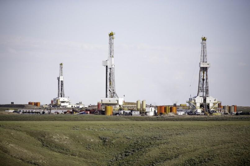 Three hydro-fracking derricks sitting on a plain