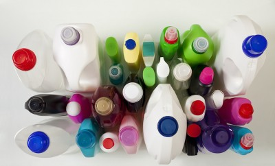 Plastic domestic containers and caps in different colors shot from above