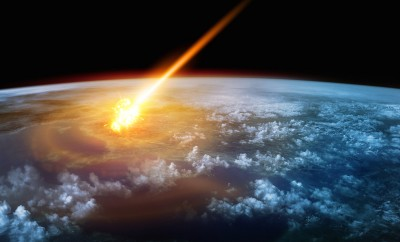 a meteor glowing as it enters the earths atmosphere