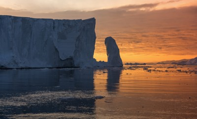 Big iceberg and Midnight sun light on the arctic ocean in Ilulissat, Greenland