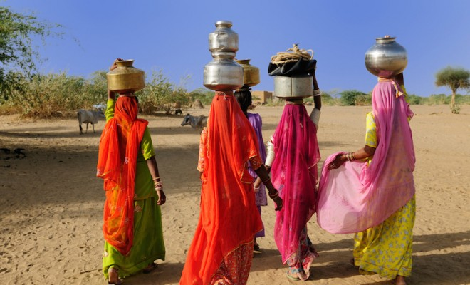 Thar desert near Jaisamler. Ethnic women going for the water in well on the desert. Rajasthan, India