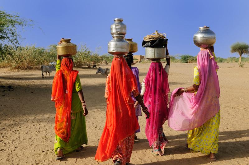 Thar desert near Jaisamler. Ethnic women going for the water in well on the desert. Rajasthan, India