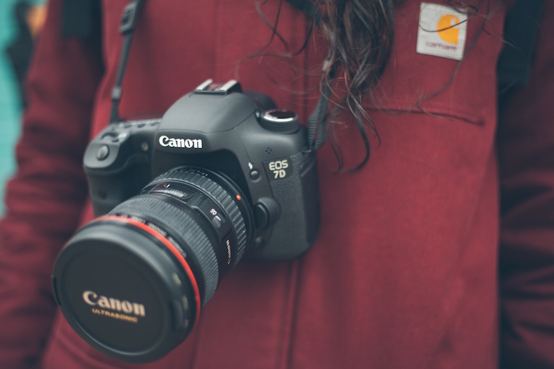 red carhart jacket dark wavy hair canon camera photography climate heroes cop22