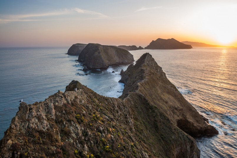 Gorgeous island coastline, cliffs and sunset